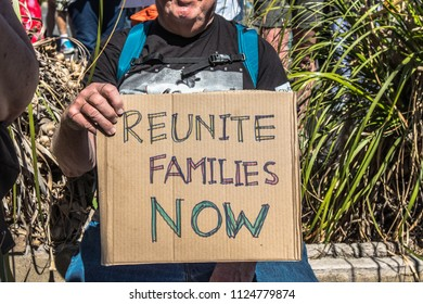 Petaluma, CA/USA-June 30, 2018: Man holds cardboard sign during Keep Families Together March