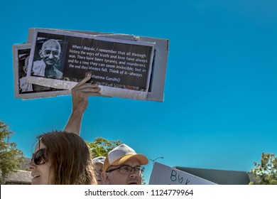Petaluma, CA/USA-June 30, 2018: Man holds sign with Ghandi quote  during Keep Families Together March