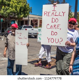 Petaluma, CA/USA-June 30, 2018: Men carry signs during Keep Families Together March