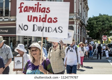 Petaluma, CA/USA-June 30, 2018: People carry signs during Keep Families Together March. One sign is in spanish