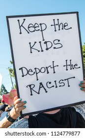 Petaluma, CA/USA-June 30, 2018: Person holds sign -Keep the Kids, Deport the Racist - during Keep Families Together March