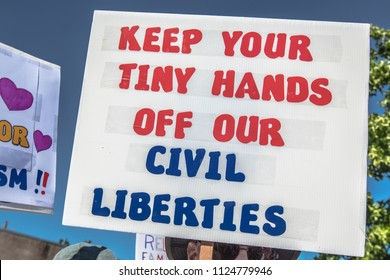 "Petaluma, CA/USA-June 30, 2018: Sign says, ""Keep Tiny Hands of Civil Liberties"" during Keep Families Together March"