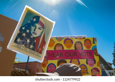 Petaluma, CA/USA-June 30, 2018: Sunflare on signs during Keep Families Together March