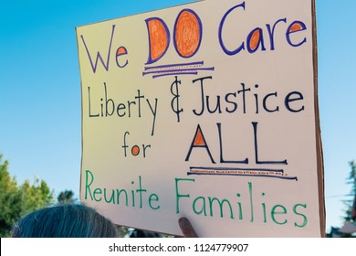 Petaluma, CA/USA-June 30, 2018: We Care sign during Keep Families Together March
