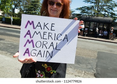 Petaluma, CA/USA-June 30, 2018: Woman holds sign - Make America Moral Again (Mama) - during Keep Families Together March