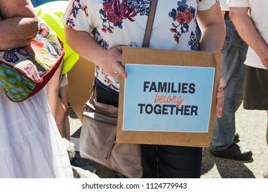 Petaluma, CA/USA-June 30, 2018: Woman holds small sign - families belong together- sign during Keep Families Together March