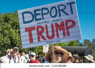 Petaluma, CA/USA-June 30, 2018: Woman holds sign asking for deportation of President Trump during Keep Families Together March