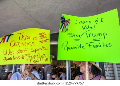 Petaluma, CA/USA-June 30, 2018: Women hold up hand made signs during Keep Families Together March