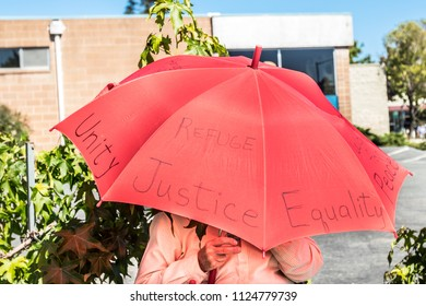 Petaluma, CA/USA-June 30, 2018: Writing on umbrella during Keep Families Together March