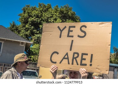Petaluma, CA/USA-June 30, 2018: Yes I Care sign during Keep Families Together March