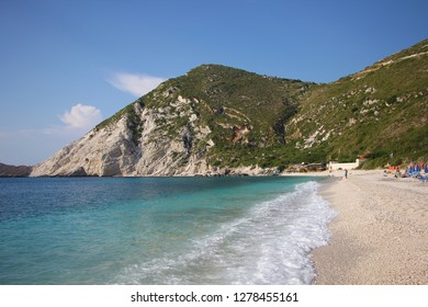 Petani Beach, Kefalonia, Greece. Beautiful beach with white stone and crystal clear water at rocky coast on Kefalonia island (Ionian island) in Greece. Amazing Landscape. World famous beach.
