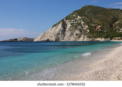 Petani Beach, Kefalonia, Greece. Beautiful beach with white stone and crystal clear turquoise water at rocky coast on Kefalonia island (Ionian island) in Greece. Amazing Landscape. World famous beach.