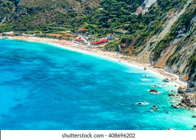 Petani beach, Kefalonia island, Greece. View of Petani bay and beautiful beach, Kefalonia island, Greece. People relaxing at the beach.