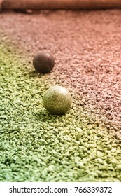 petanque ball on groung, two tone color