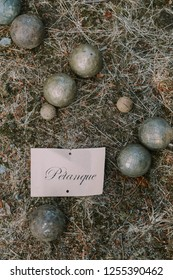 Petanque balls with the name Petanque on the ground