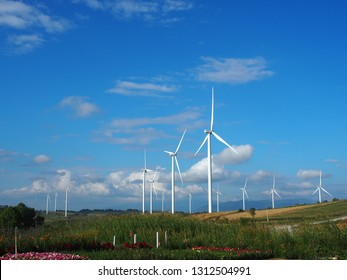 Petchabun, Thailand - November 2018: Wind turbine farm located on the green mountains at Khao Kho is surrounded by the nature and beautiful view which is now turning a tourist destination.