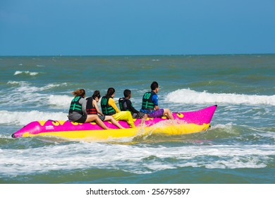 Petchaburi- Feb 21:  Tourists enjoying ride a Banana Boat adventure on February 21,2015 in Petchaburi Thailand.