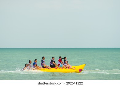 Petchaburi- Jun 28: Tourists enjoying ride a Banana Boat adventure on June 28,2015 in Petchaburi Thailand.