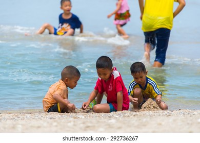 Petchaburi- Jun 28: Tourists enjoying on Cha-Am beach on June 28,2015 in Petchaburi Thailand.