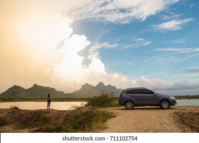 Petchburi ,Thailand -August 30 2017: Private car test drive, Gray color Chevrolet Captiva Photo on country road in sunset time at 300 Yod Mountain,Thailand