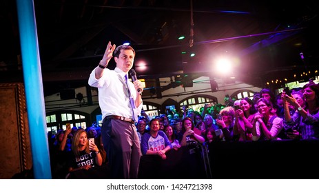 Pete  Buttigieg talking to a crowd with a mic in hand smiling at The Abbey Los Angeles California 2019 presidential candidate Democrat lgbt Gay Mayor