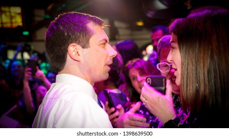 Pete Buttigieg talking to a crowd. Wearing a white button down shirt with a thin blue tie.  Presidential Candidate for 2020 May 15 2019 Los Angeles grassroots fundraiser at The Abbey Gay bar lgbtq