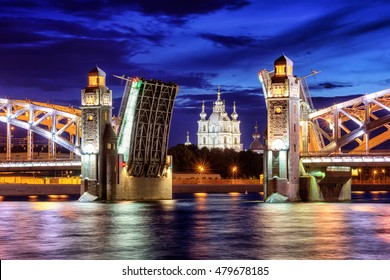Peter the Great Bridge and Smolny Cathedral at summer white night time, St Petersburg, Russia