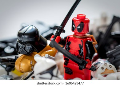 PETERBOROUGH, CAMBRIDGESHIRE, ENGLAND- APRIL 2, 2018: Macro of lego figures fighting. There can only be one winner!