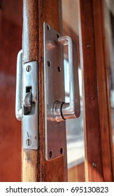 PETERBOROUGH, CAMBRIDGESHIRE, UK - CIRCA AUGUST 2017: Close-up view of a vintage styled sliding door locking system as seen on a first class corridor passenger train, seen here unlocked.