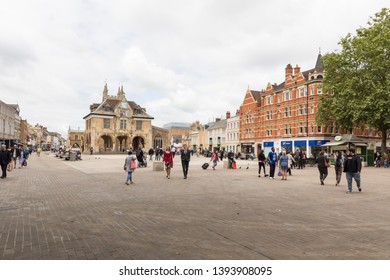 Peterborough, Cambridgeshire / UK - June 12th 2018: Cathedral Square, an open space with shoppers, business people and tourists walking through it. In the background is the Old Guild Hall.