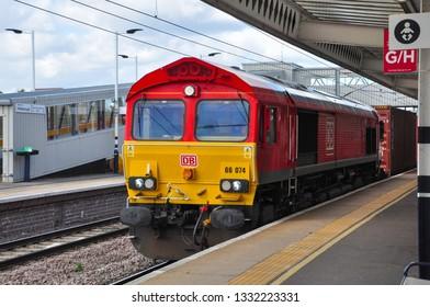PETERBOROUGH, CAMBRIDGESHIRE/UK - March 5, 2019. Class 66 diesel heads a southbound freight through Peterborough, Cambridgeshire, England