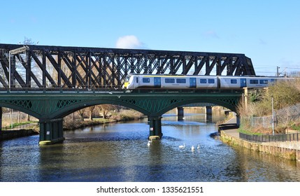 PETERBOROUGH, CAMBRIDGESHIRE/UK - March 5, 2019. Thameslink class 700 EMU heads south on the cast iron bridge over the River Nene, Peterborough, Cambridgeshire, England