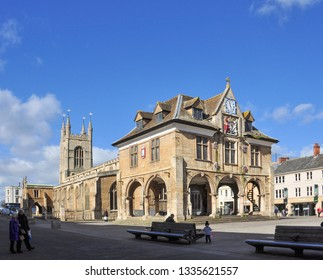 PETERBOROUGH, CAMBRIDGESHIRE/UK - March 5, 2019. Guildhall with the Church of St John the Baptist behind, Cathedral Square, Peterborough, Cambridgeshire, England