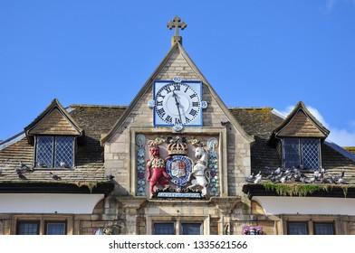 PETERBOROUGH, CAMBRIDGESHIRE/UK - March 5, 2019. Clock and Emblem on Guildhall, Cathedral Square, Peterborough, Cambridgeshire, England