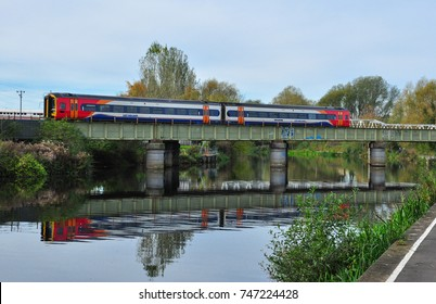 PETERBOROUGH, CAMBRIDGESHIRE/UK - October 30, 2017. Class 158 DMU crosses the River Nene at Peterborough, Cambridgeshire, England