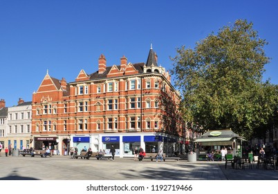 PETERBOROUGH, CAMBRIDGESHIRE/UK - September 27, 2018. Buildings on the corner of Exchange Street and Long Causeway, Cathedral Square, Peterborough, Cambridgeshire, England