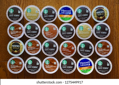Peterborough, Canada - December 5, 2018:   Top view of various Keurig K-cups pods in the wooden table in the kitchen.