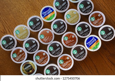Peterborough, Canada - December 5, 2018:   Top view of Keurig K-cups pods in the wooden table in the kitchen.