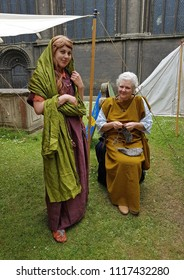 Peterborough, England - June 17, 2018:  Two ladies dressed in rich Roman costume, during the annual Peterborough Heritage Festival.
