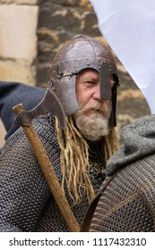 Peterborough, England - June 17, 2018:  A man in full Viking costume, prepares to march with other warriors as part of the Peterborough Heritage Festival