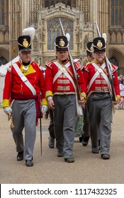 Peterborough, England - June 17, 2018:  Reenactors dressed as Napoleonic era Soldiers of the 9th Regiment of Foot. March outside Peterborough Cathedral during the Heritage Festival.