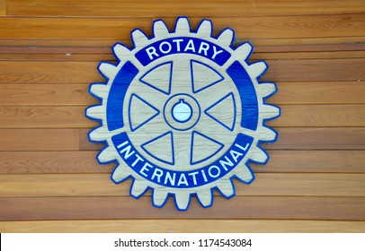 Peterborough, Ontario, Canada - August 31, 2018: Sign of Rotary Club International in a wooden background.