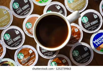 Peterborough, Ontario, Canada - December 5, 2018: A cup of coffee above assorted Keurig k-cup pods.