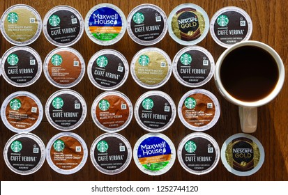 Peterborough, Ontario, Canada - December 5, 2018: Top view of a cup of coffee and assorted Keurig k-cup pods in the table.