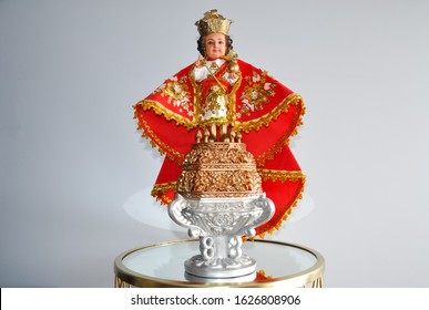 Peterborough, Ontario, Canada - January 16, 2020: Image of Señor Sto. Nino standing in  a glass table.