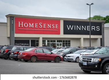 Peterborough, Ontario, Canada - May 30, 2020: People are seen lining up at the entrance of Homesense and Winners Store.