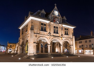 PETERBOROUGH, UK, - FEBRUARY 12, 2018. Peterborough Guildhall is an example of historic architecture in the city centre of peterborough, UK and shown at night illuminated by lights.