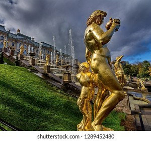 Petergof, Russia - 09/14/2018: A large cascade of fountains is the most grandiose construction of the Petergof. Sculpture of Bacchus and Satyr.