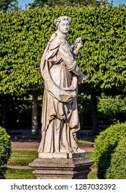 Petergof, Russia - 09/14/2018: Sculpture of Flora in the Upper park. Roman goddess, whose cult was spread among the Sabines, and especially in Central Italy. She was the goddess of flowers, blossoming