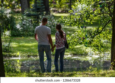 "PETERGOF / RUSSIA - AUGUST 2015"": Young couple in palace park of Petergof, Russia"